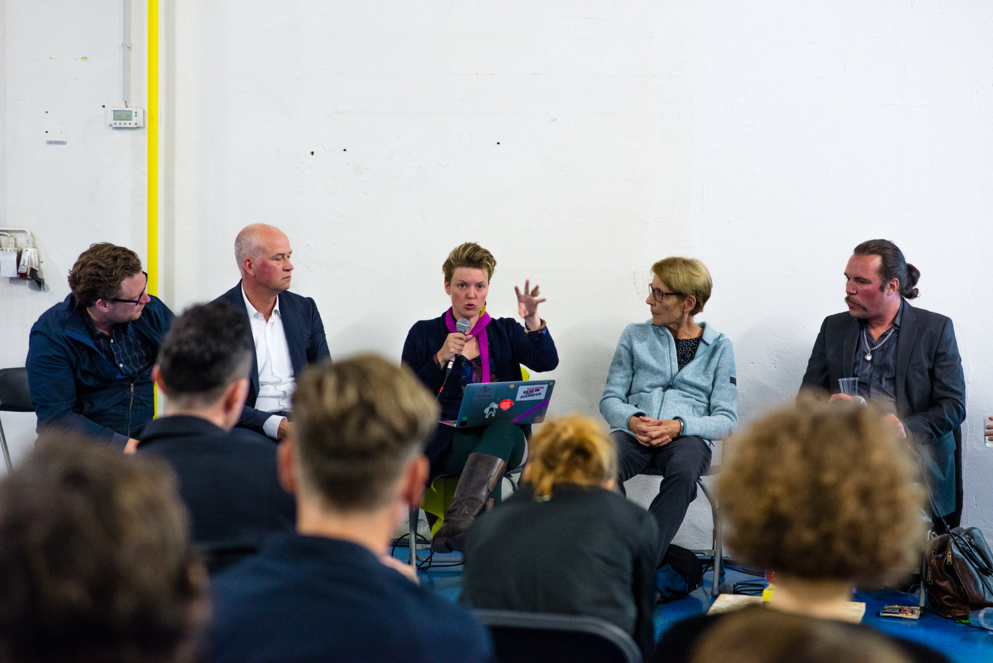"<p><b>How to Breathe In a Bubble?<br /> </b><strong>An experimental discussion panel</strong> with Marco Schmitt (performance artist and systems coach), Katalin Gennburg (speaker for urban development, tourism and smart city of the Left Fraction in the Berlin House of Representatives), Andreas Krüger (director of Belius GmbH, former director of Modulor, Runder Tisch Liegenschaftspolitik), Sven Lemiss (director BIM), Sandra Meireis (architecture theorist, TU Berlin), Zoe Claire Miller (artist, co-founder Berlin Art Prize), Martin Schwegmann (urban researcher, studio commissioner for Berlin), Alexandra von Stosch (Artprojekt Unternehmensgruppe), Cornelia Wagner (OraNostra)</p> <p><i>""Everything is gentrification now"" but Richard Florida isn't sorry.</i> As the city gets more expensive, more tightly packed, some win, others lose. On this evening, Marco Schmitt and participants from art, politics, and real estate attempted to untangle the socio-economic complex of gentrification using Schmitt's method of COA CHING. What (moral) scope of action is possible, for those affected and those responsible, when urban space is subject to intense pressure and scarcity?</p>"